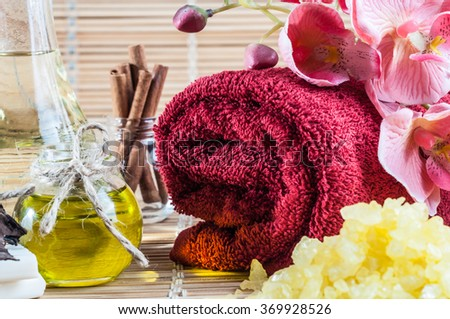 spa, oils, cinnamon and beautiful pink orchid - stock photo