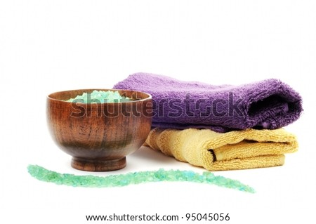 Spa or bathroom concept with towels and salt, on a white background - stock photo
