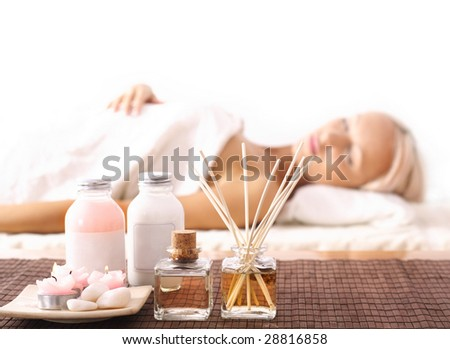 SPA relaxing. Young woman lying at spa and relaxing. waiting for massage therapy - stock photo