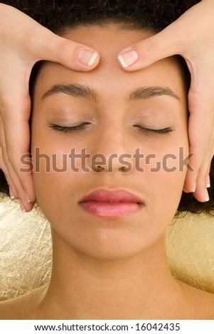 Spa resort. Beautiful girl receiving head massage - stock photo
