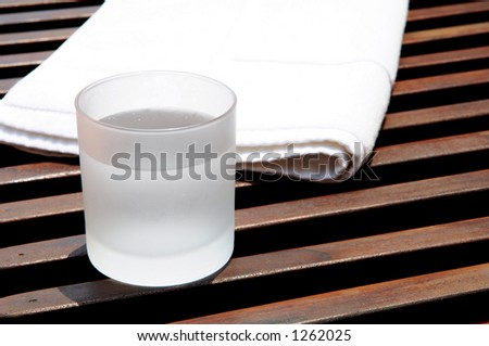 spa resort - white towel and cool drink - stock photo