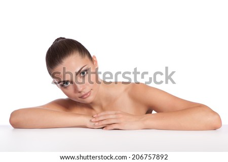 Spa salon. Girl lying on a massage table and relax - stock photo
