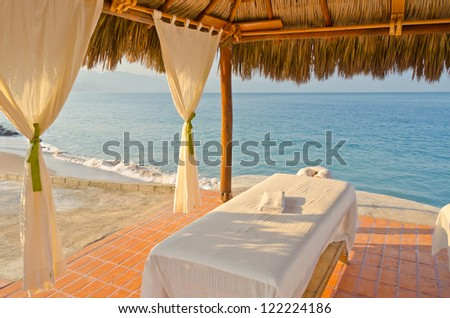 Spa salon on beach of tropical island - healthcare background - stock photo