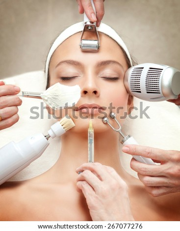 Spa Salon: Young Beautiful Woman Having Different Facial Treatment - stock photo