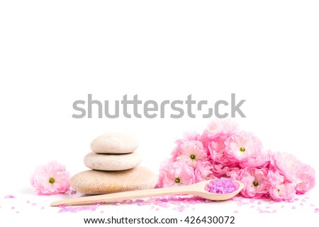 Spa salt and stones, flower branch for beauty and health. Healthy relaxation, therapy and treatment. Aromatherapy, body care, aroma massage. Alternative lifestyle. Relax in bath. - stock photo