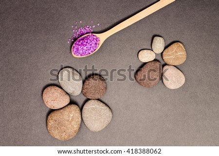 Spa salt on wooden spoon and stones for beauty and health. Healthy relaxation, therapy and treatment. Aromatherapy, body care, aroma massage. Alternative lifestyle.  - stock photo