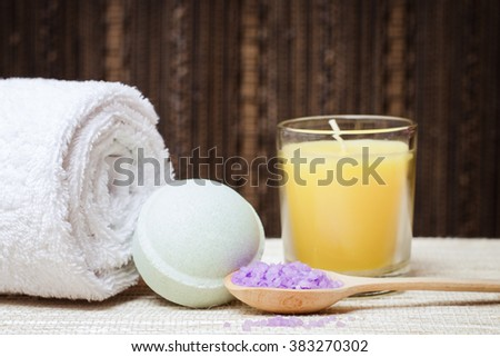 Spa salt, stones, towel and bath bomb for beauty and health. Healthy relaxation, therapy and treatment. Aromatherapy, body care, aroma massage. Alternative lifestyle. Relax in bath. - stock photo