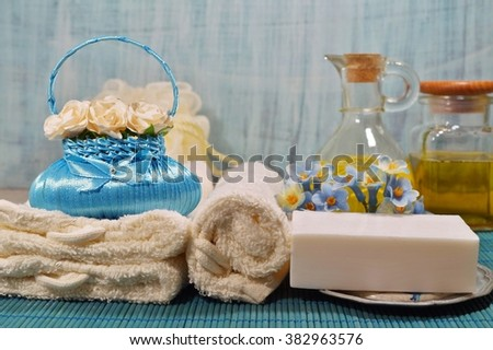 SPA - scented soap and aromatic basket with flowers, scented candles and massage oil - stock photo