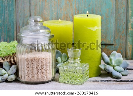 Spa set: green sea salt, scented candles, liquid soap and essential oils - stock photo
