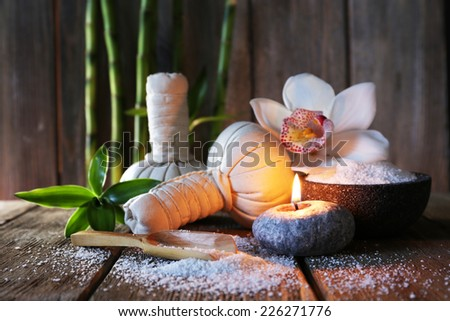 Spa set on wooden surface on wooden wall background - stock photo