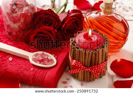 Spa set: scented candle, sea salt, liquid soap and romantic red roses - stock photo