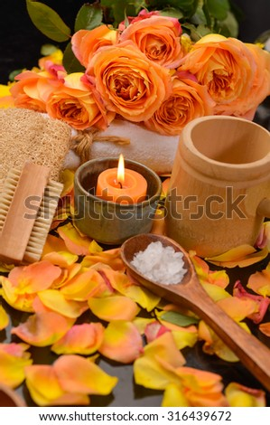 Spa Set with many rose petals with towel, oil  - stock photo
