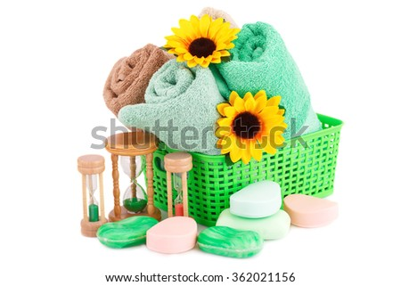 Spa set with towels, sandglasses, soap bars and flowers isolated on white background. - stock photo
