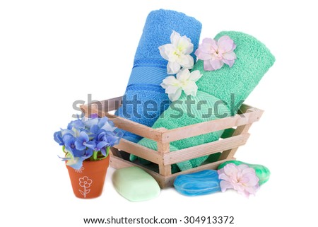 Spa set with towels, soaps and flowers isolated on white background. - stock photo
