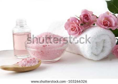 spa setting /bath salt in bowl with pink rose and massage oil - stock photo