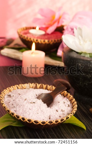 Spa setting  in pink tones with candles - stock photo