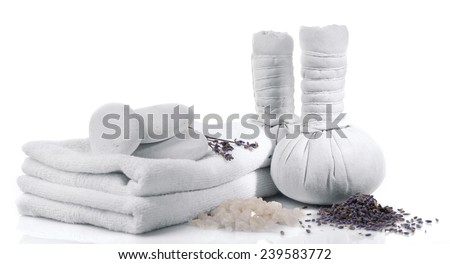 Spa setting on table isolated on white - stock photo