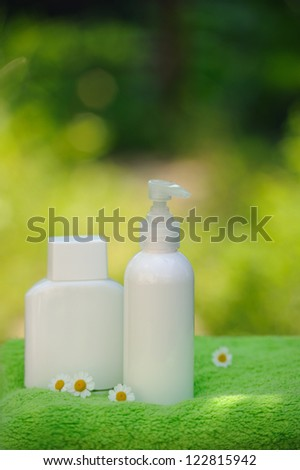 Spa setting, treatment with camomile flowers