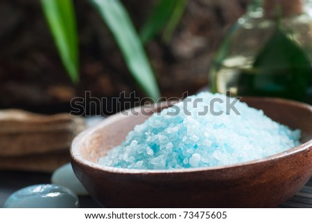 Spa setting with bath salt and floral water - stock photo