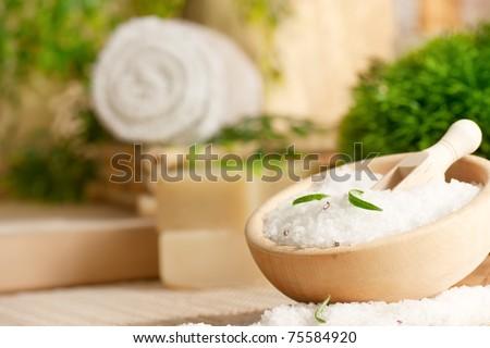 Spa setting with bath salt and towel. - stock photo