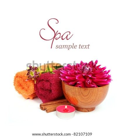 Spa setting with beautiful pink flower, towel, candle, cinnamon over white background