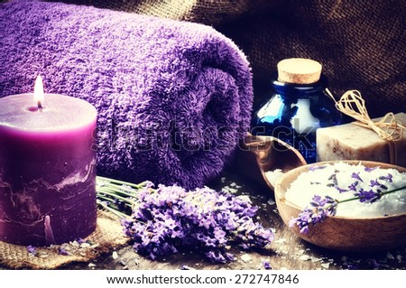 Spa setting with candle and lavender flowers. Wellness concept - stock photo