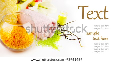 Spa setting with candle, salt and palm branch.  (With sample text) - stock photo
