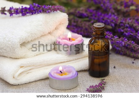 Spa setting with candles and lavender flowers - stock photo