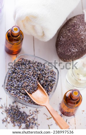 Spa setting with lavender on white painted wooden background. Selective focus. - stock photo