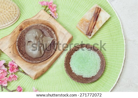 Spa setting with natural cinnamon pumpkin  soap, spa mud and green tea salt. Macro photograph, selective focus - stock photo