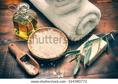 Spa setting with natural olive soap and sea salt  - stock photo