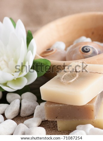Spa setting with natural soaps and lotus flower. For similar photos please check my gallery. - stock photo