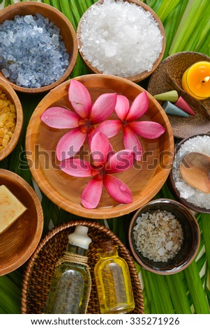 Spa setting with perfume ,spoon on palm    - stock photo