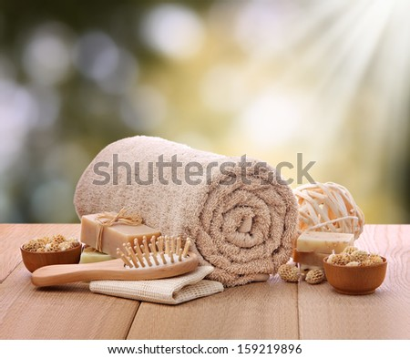Spa setting with rolled towel - stock photo