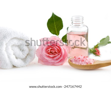 Spa setting with rose ,salt in spoon, oil with towel - stock photo