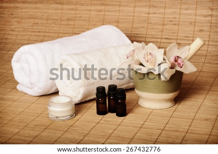 Spa setting with white orchids - stock photo
