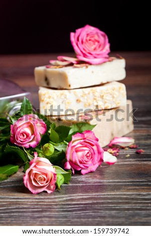 Spa Settings with roses and salt in bowl , towel. Candle,soap on straw mat