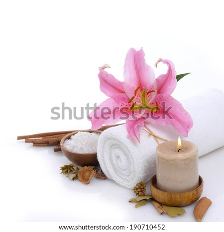 Spa sitting with cinnamon, lily with salt in bowl, towel   - stock photo