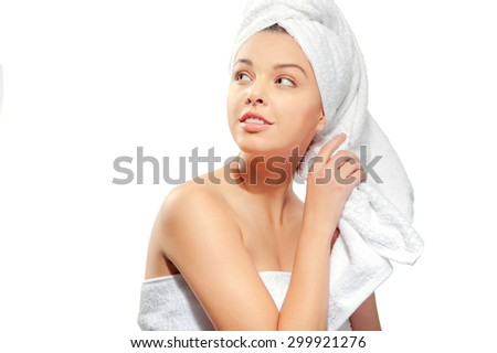 Spa skin care beauty woman wearing hair towel after beauty treatment. Beautiful young woman with perfect skin isolated on white background. - stock photo