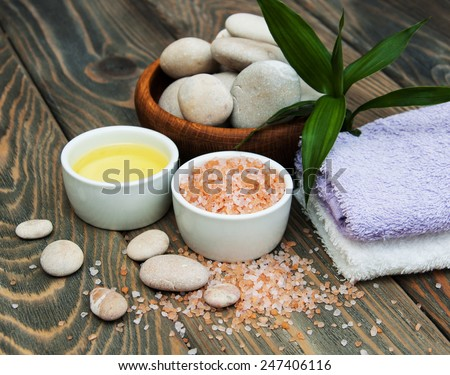 spa still life - spa accessories and towels  on a wooden background - stock photo