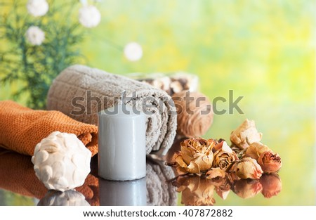 spa still life  with candle  and dry rose petals on green background - stock photo