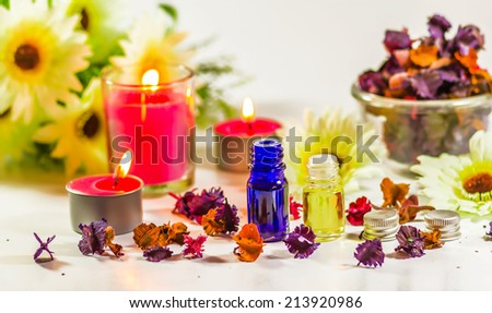 Spa still life with candle and flowers - stock photo