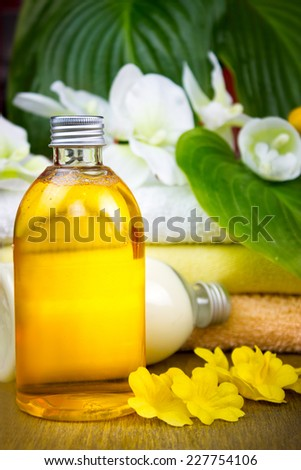 Spa still life with essential oil and towel  - stock photo
