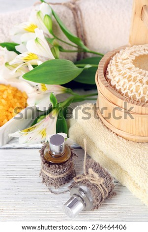 Spa still life with flower on wooden table, closeup - stock photo