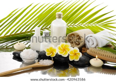 Spa still life with frangipani ,palm and black stone, candle,.towel,  - stock photo