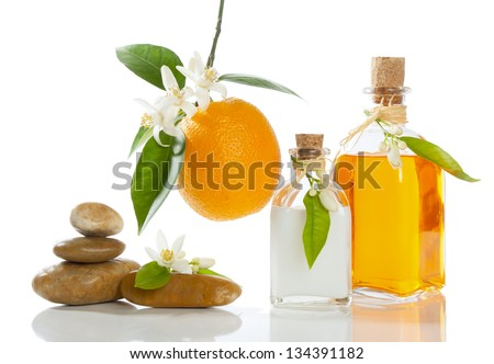 spa still-life with orange oil, cream ; blossom and fruit  isolated on white - stock photo