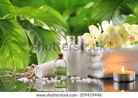 Spa still life with perfume bottles,towel and candle - stock photo