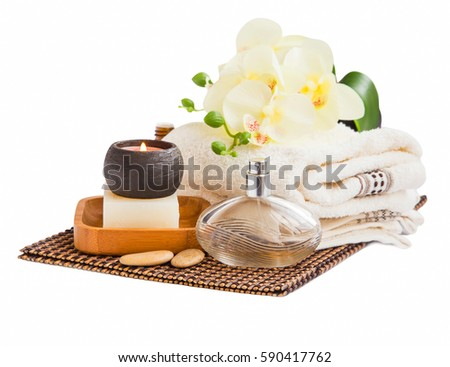 Spa still life with towels and orchid flower, towels,candle and natural soap