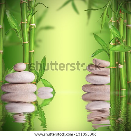 Spa still life with white stones and bamboo sprouts with free space for text - stock photo