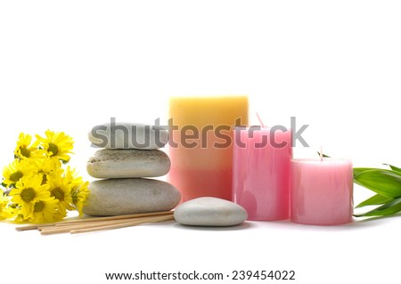 Spa still life with yellow flower and stacked stones with candle  - stock photo